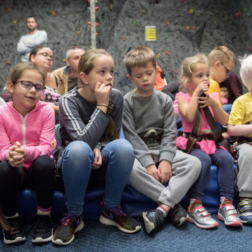 Children sat in a line waiting for the BBS Festival of sport to begin